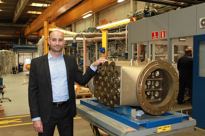 DESMI Ocean Guard CEO Rasmus Folsø in front of CompactClean UV unit